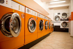 Laundromat. An interior of a retro looking laundromat royalty free stock photo