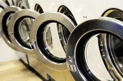 Laundromat. A row of industrial washing machines in a public laundromat royalty free stock images