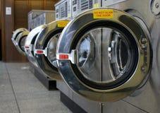 Laundromat. SONY DSC washing machine doors left open in a laundromat royalty free stock image