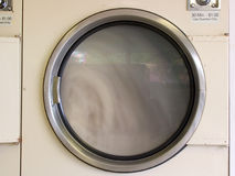 Laundromat dryer running Stock Images