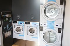 Laundromat dryers row of industrial machines clothes washers stock photos