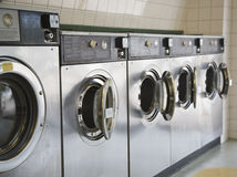Laundromat front loading washers Stock Photography