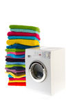 Laundromat with laundry. Laundromat with pile of colorful towels isolated over white background stock images