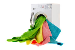 Laundromat with laundry. White laundromat with colorful landry in open door stock photo