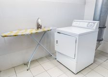 Laundromat. Laundry room for clothes. Iron and washing machine stock photography