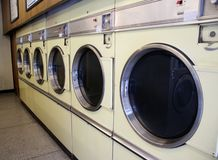 Laundromat Machines. SONY DSC Laundromat washing Machines six in a row in a launderette in uk stock image
