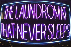 Laundromat That Never Sleeps. The Laundromat That Never Sleeps, neon sign Royalty Free Stock Photo