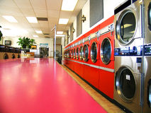 Laundromat Retro. Perspective on laundry in retro orange royalty free stock photos