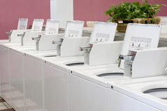 Laundromat Washers. Row of top-loading washers at a laundromat Royalty Free Stock Photo
