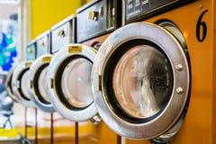Laundromat Washing machines. Row of washing machines in a laundromat stock photos