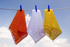 Laundry. Colored cloth lying in the sun cerca stock photos
