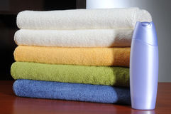 Laundry. Softness liquid bottle with clean towels Royalty Free Stock Photo