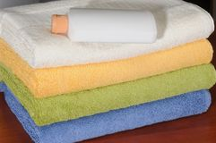 Laundry. Softness liquid bottle with clean towels Stock Photography