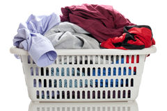 Laundry. In a basket on a white background Stock Images