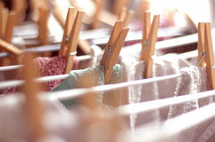 Laundry. Clean laundry, with wooden clothes pins Stock Photography