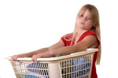 Laundry. Young girl helping with laundry carrying laundry basket Stock Photography
