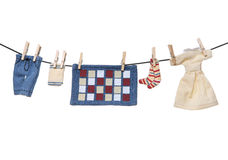 Laundry. Several pieces of laundry drying on a clothes line over white Stock Photography
