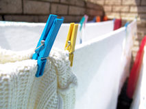 Laundry. On the washing line with one peg in focus stock images