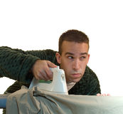 Laundry. A man doing his laundry and ironing his clothes Stock Photos