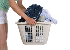 Laundry. Woman holding the dirty laundry Royalty Free Stock Photos