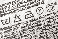 Laundry advice clothing tag Stock Images