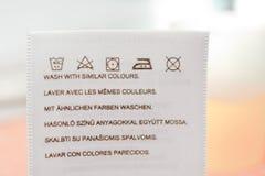 Laundry advice clothing tag. Stock Images