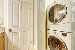 Laundry appliances in small rooom Stock Photography