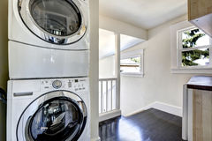 Laundry area with modern white appliances Stock Photography