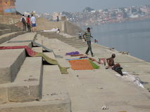 Laundry Assi Ghat Varanasi India. A typical day on the ghat in Varanasi, India, on the bank of the Ganges River. Laundry drying in the sun as tourists stroll the Royalty Free Stock Photos