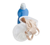 Laundry bag bras against the background of a detergent Stock Image
