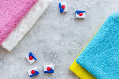 Laundry. Bars of dry detergent near clean towel on grey stone background top view copyspace Royalty Free Stock Photo