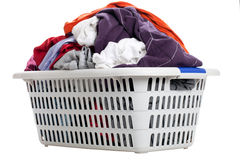 Laundry in a basket. On a white background Royalty Free Stock Photography