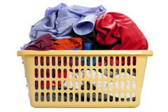 Laundry in a basket. On a white background Stock Image