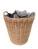 Laundry in a basket. Isolated on white Stock Image