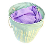 Laundry in a basket. Isolated on white Stock Photo