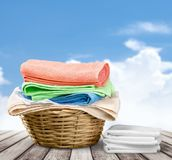 Laundry Basket with colorful towels on background. Colorful basket laundry towels colors background nobody Stock Images