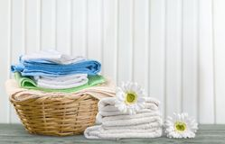 Laundry Basket with colorful towels on background. Colorful basket laundry towels colors background nobody Stock Photos