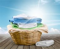 Laundry Basket with colorful towels on background. Colorful basket laundry towels colors background nobody Stock Photo