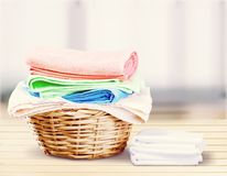 Laundry Basket with colorful towels on background. Colorful basket laundry towels colors background nobody Royalty Free Stock Photography