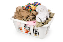 Laundry basket and dirty clothing Stock Photos