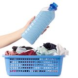 Laundry basket dirty wash clean bottle of liquid powder conditioner softener in hand. On white background isolation Stock Image