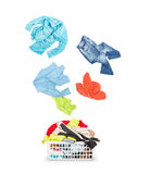 Laundry in a basket and falling clothes - isolated on a white Royalty Free Stock Photos