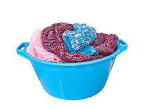 Laundry basket filled with winter sweaters Stock Photo