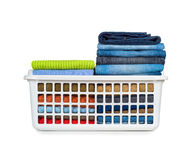 Laundry basket with folded clothes. Over white background Royalty Free Stock Photos