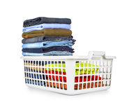 Laundry basket with folded clothes Royalty Free Stock Photos