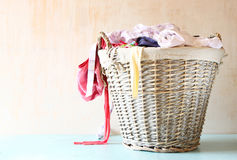 Laundry basket full with clothes Royalty Free Stock Images