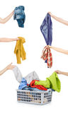 A laundry basket full of dirty clothes ready to be washed during Stock Image
