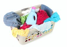 Laundry Basket Full of Dirty Clothes and Softener. On White Background Stock Images