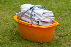 Laundry basket in grass Stock Photography