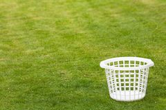 Laundry basket on lawn Royalty Free Stock Photos